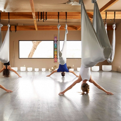 group practicing aerial yoga at miraval austin