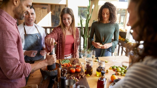 Group of guests experiences a culinary class outdoors at Miraval Austin.