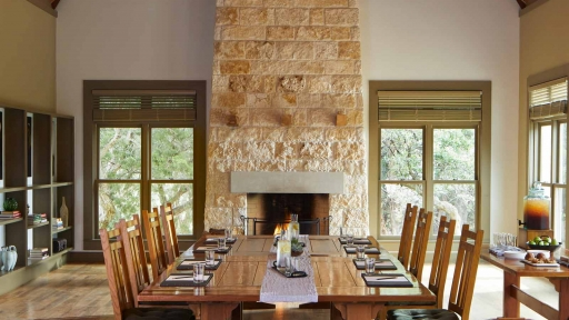 eight person set dinner table inside room with chimney