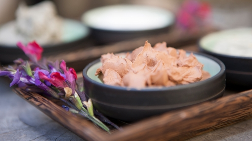 fresh flowers and flower petals used in spa treatments