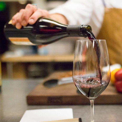 red wine being poured in glass