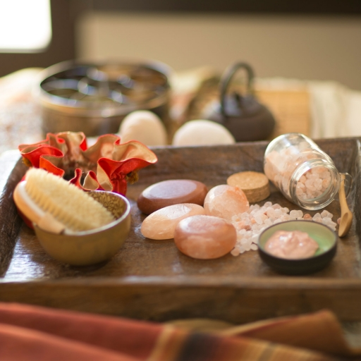 pink stones and wooden brush
