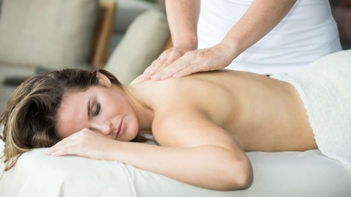 woman receiving back massage at miraval austin resort