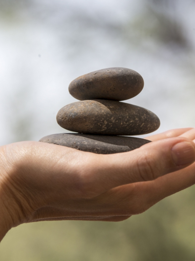 three stones stacked in a hand