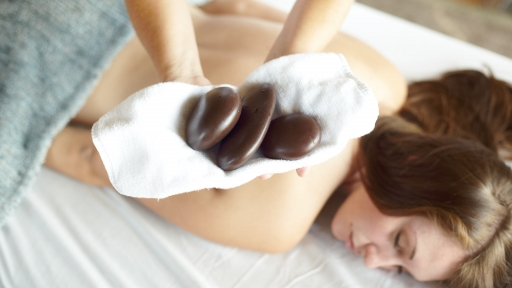 Guest getting a hot stone massage at Miraval Austin