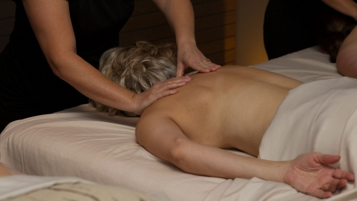 woman receiving back massage at miraval austin