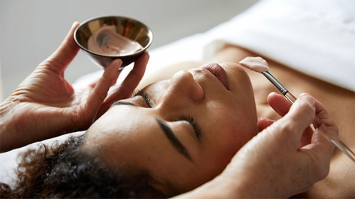 woman laying down receiving facial at miraval austin's life in balance spa
