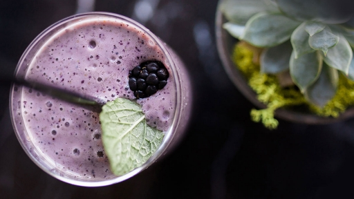 freshly garnished purple smoothie