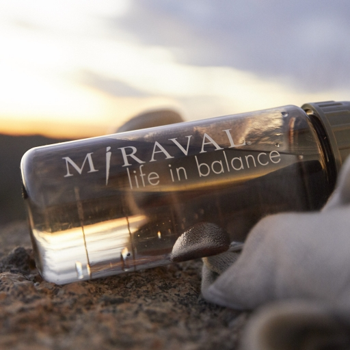 miraval water bottle in the sand