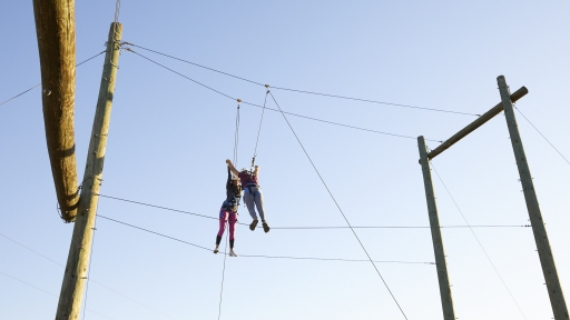 ground shot of two people on ropes course at miraval austin