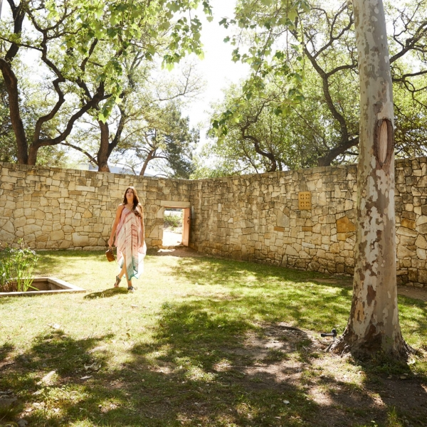 women walking through relaxing stone garden in austin texas