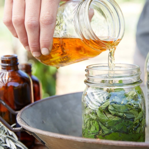 liquid being mixed with mint in a jar