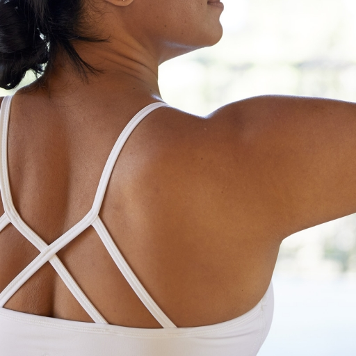 close up of tan woman's back