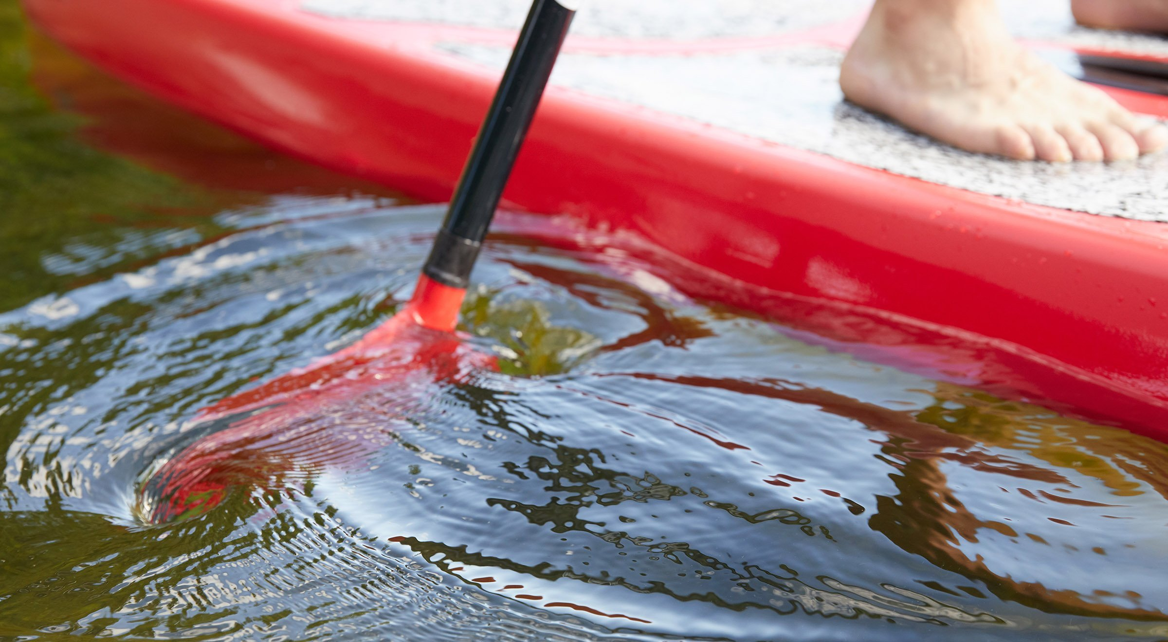 red paddle moving through water