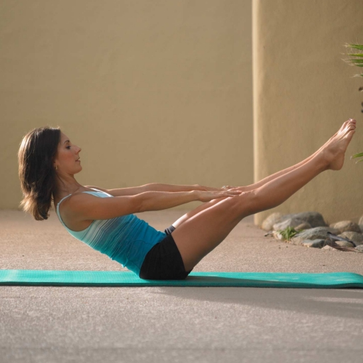 woman on blue yoga mat stretching