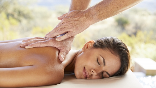 woman receiving soothing back massage in austin texas