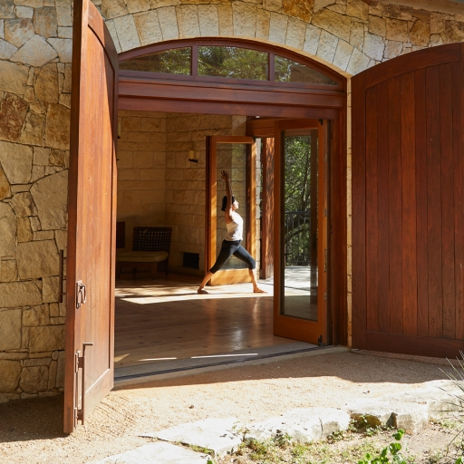 wide open doors to dojo with women stretching inside