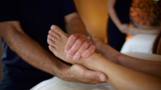 man giving a foot massage