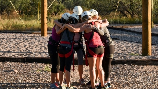 friends hugging after completing challenge course