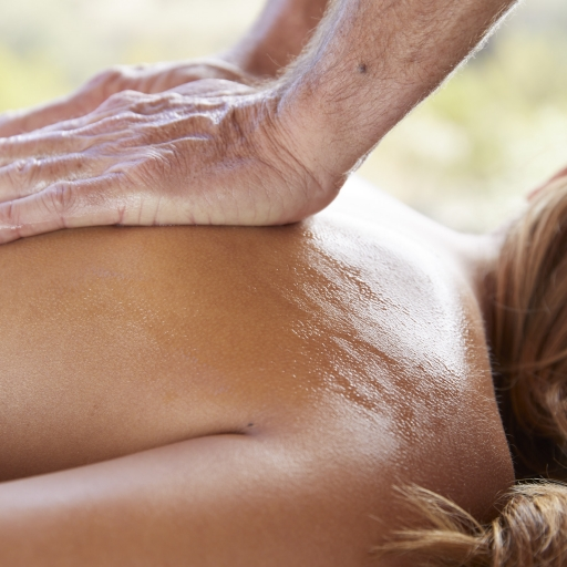 Close up of back massage treatment at the spa at Miraval Austin.