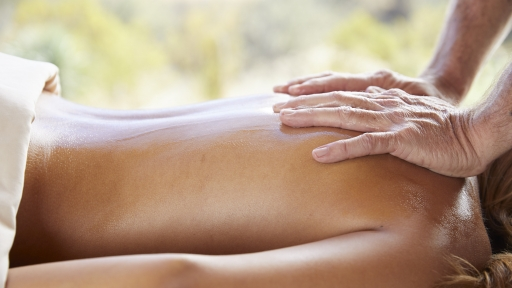 Woman enjoys relaxing back massage at the spa at Miraval Austin.