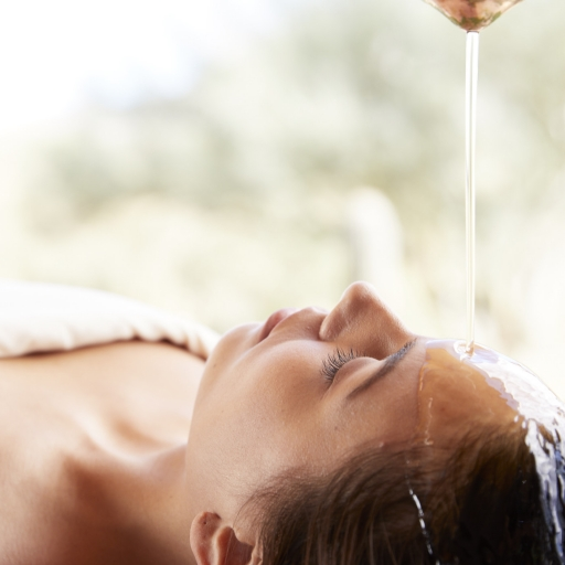 woman laying down relaxing at miraval life in balance spa in austin