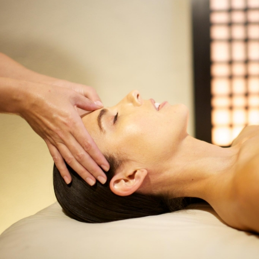 Woman enjoys delicate facial spa treatment at Miraval Austin.