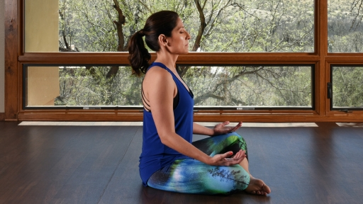 Woman relaxes during yoga meditation at Miraval Austin.