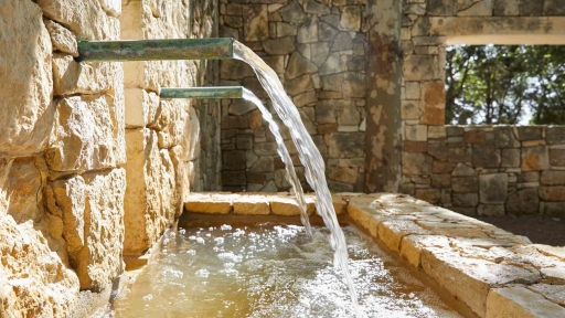 water pipes in stone wall creating water fall