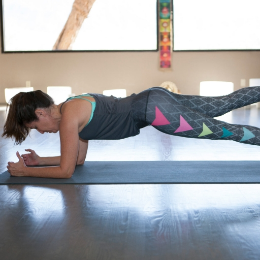 woman doing a plank on a yoga mat