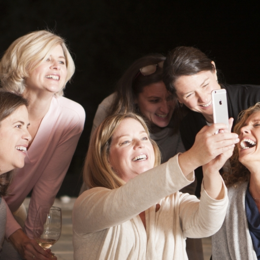 Group of guests takes a selfie during their stay at Miraval Austin.
