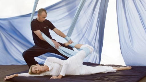 woman being stretched with workout ribbons at miraval austin