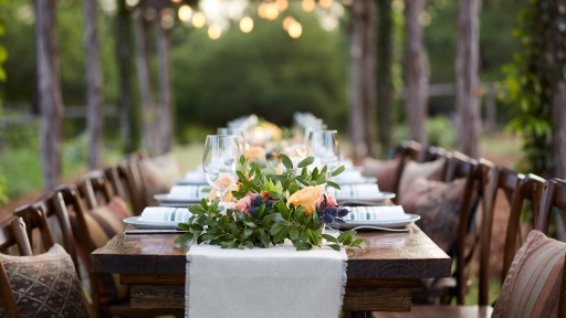 Outdoors dining table set up for event at Miraval Austin.